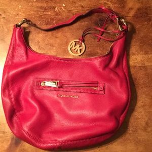 Red Michael Kors handbag